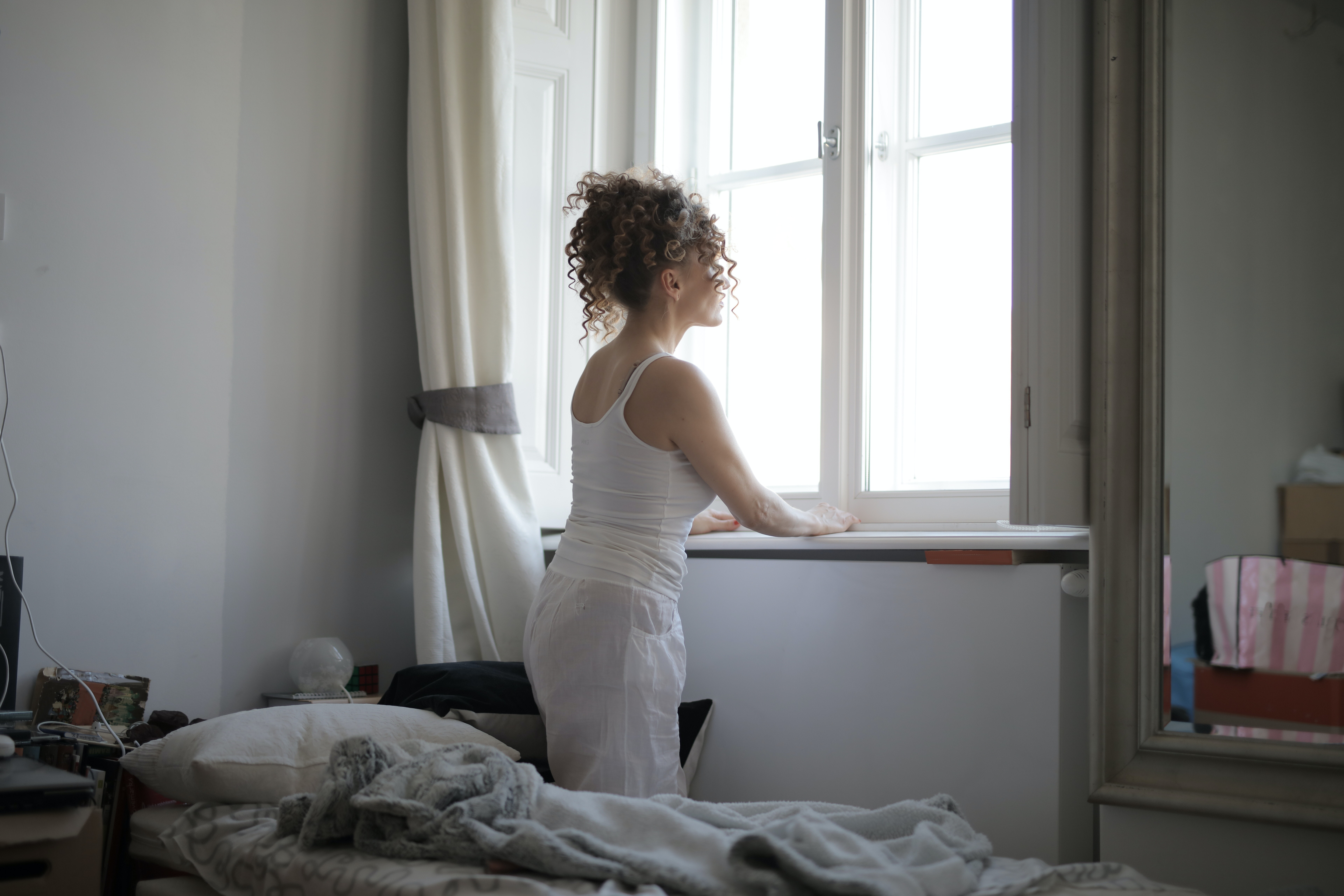 calm-woman-in-sleepwear-on-bed-at-home-3791605